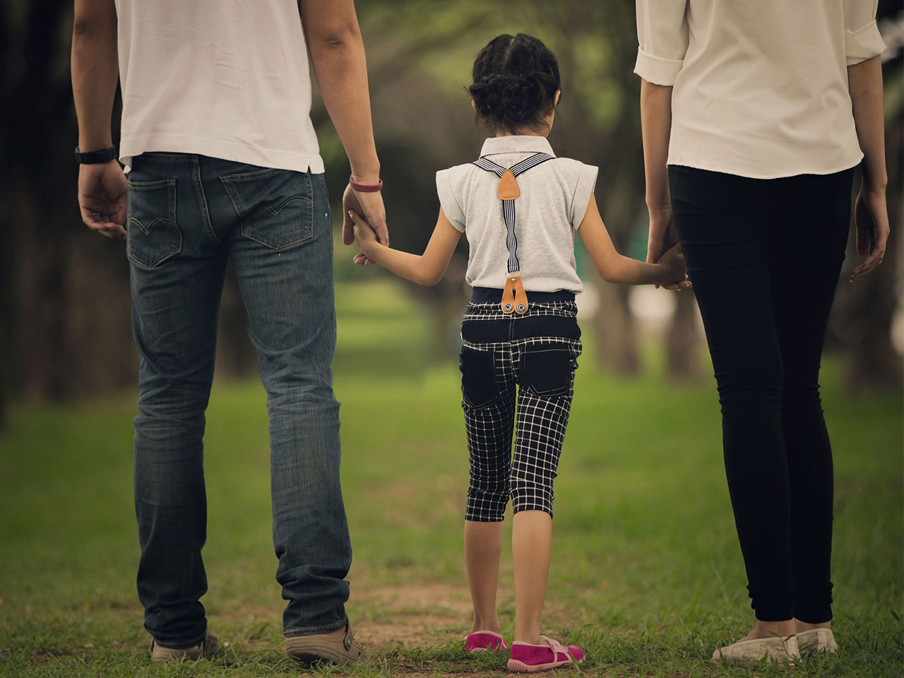 Image of family walking hand in hand