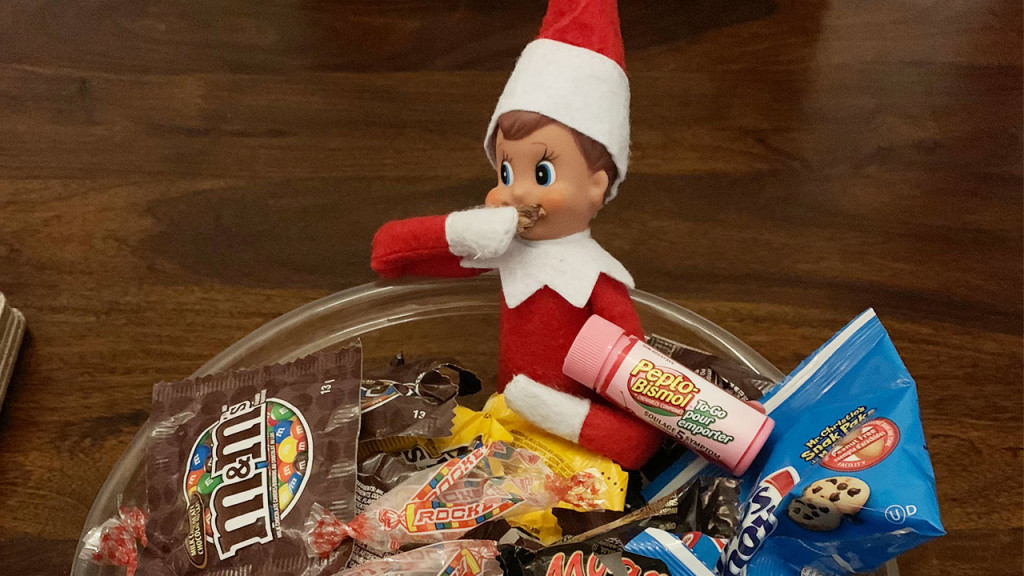 Elf on the shelf in a bowl of candy