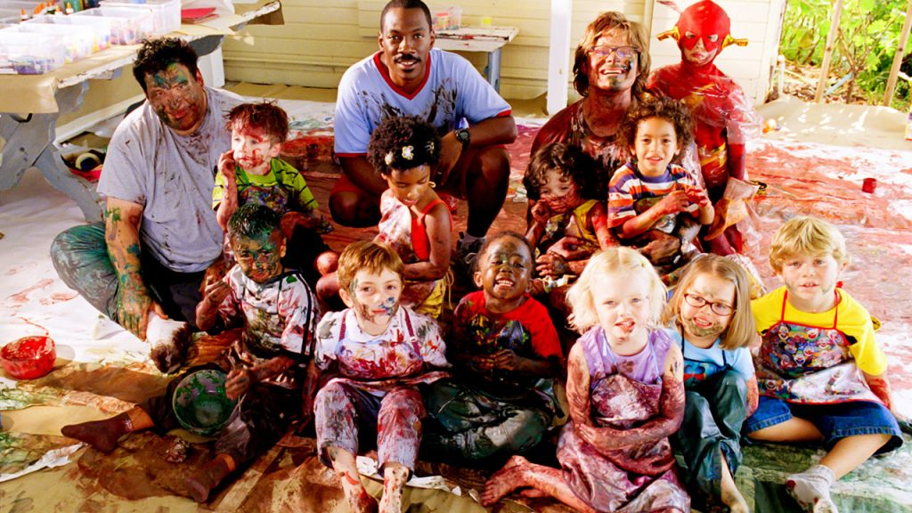 Promo image for Daddy Day care showing three dads surrounded by a but onch of kids. everyone is covered in paint