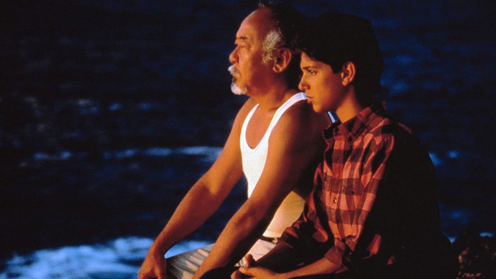 Promo image for Karate Kid part 2 showing an old man and young guy meditating