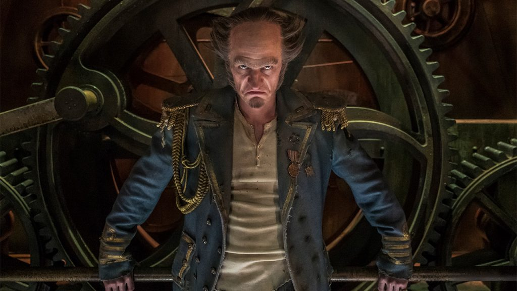 Promo image for Series of Unfortunate Events showing A man in a captains jacket in front of a wall of gears