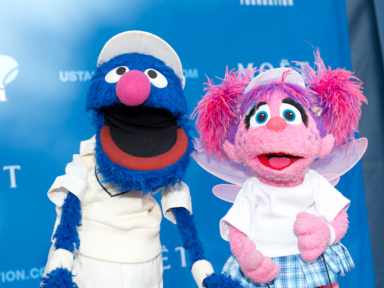Grover and Abby Cadabby from Sesame Street posing at an event