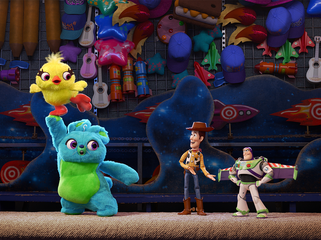 Promo image from Toy Story 4 showing woody and buzz talking to carnival prize stuffies