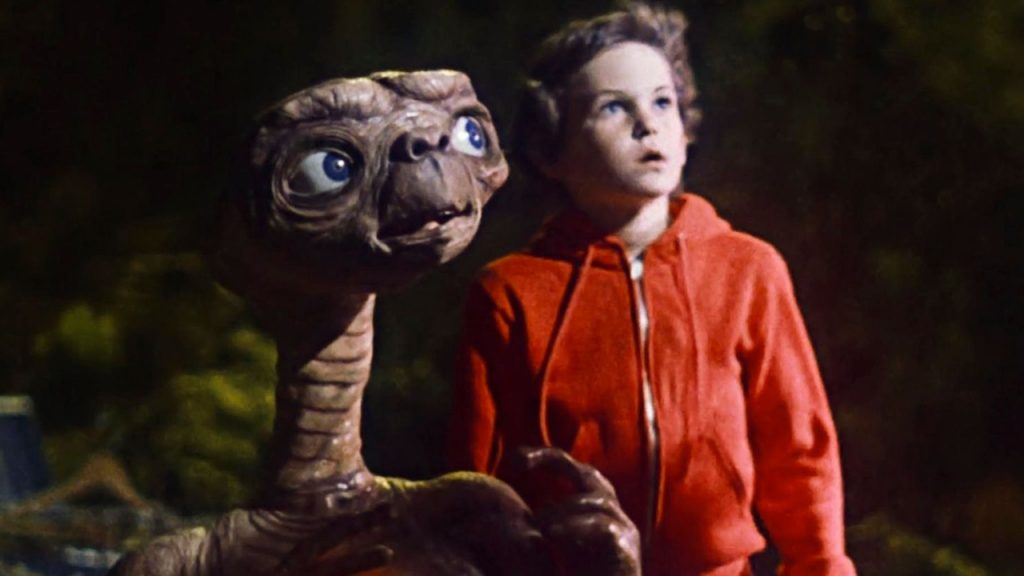 Promo image for ET Extra terrestrial showing an alien and a boy looking at the sky