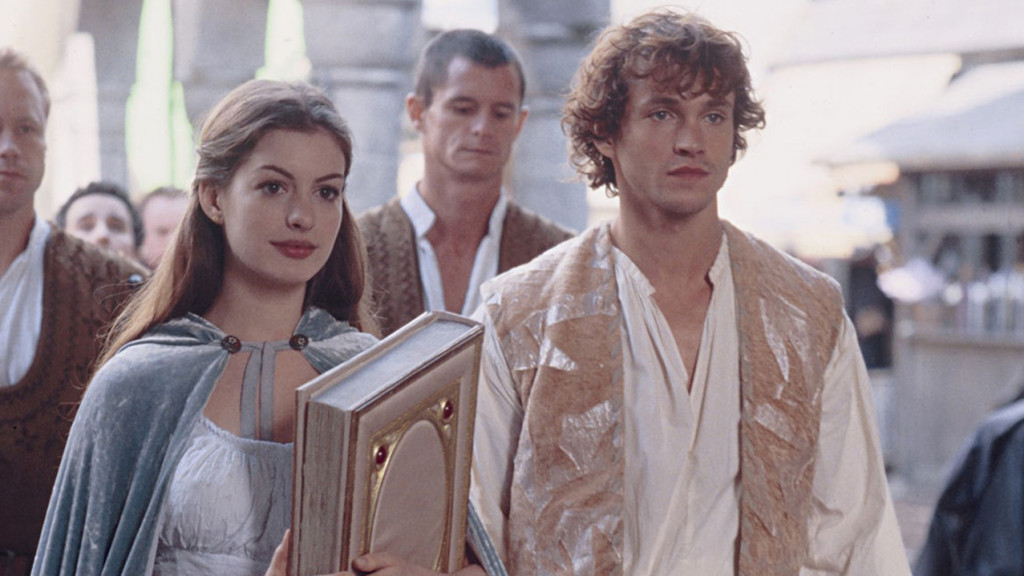 Promo image for Ella Enchanted showing a man and woman walking holding a big book