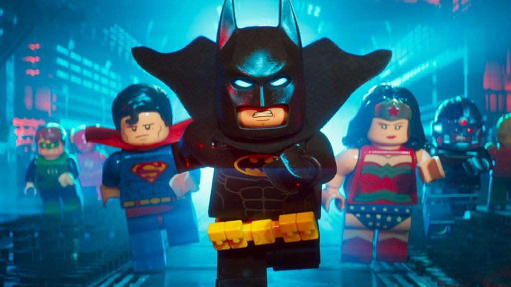 Promo image for The Lego Batman Movie showing lego batman followed by the Lego Justice League