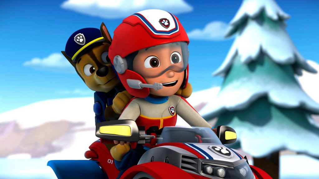 Promo image for Paw Patrol showing a boy and dog riding a snowmobile