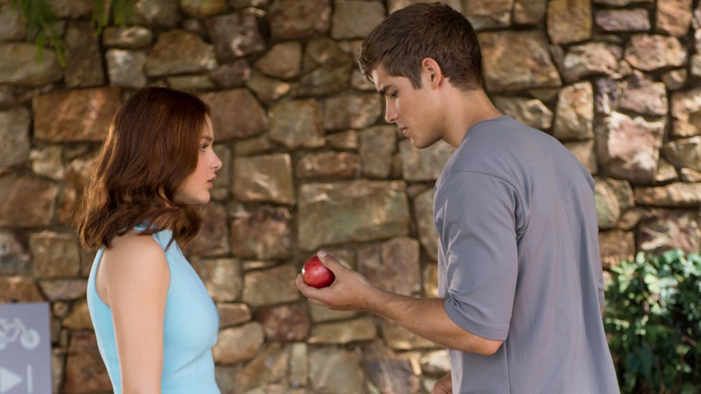 Promo image for the Giver showing a man giving a woman an apple