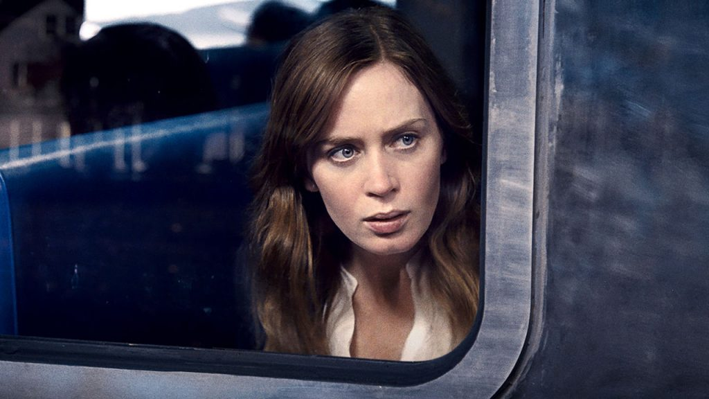 Promo image for The Girl on the Train showing a woman on a train looking out a window