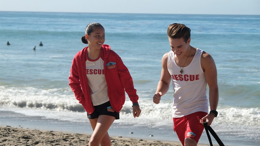 Promo image for malibu rescue showing two teen lifeguards walking on a beach