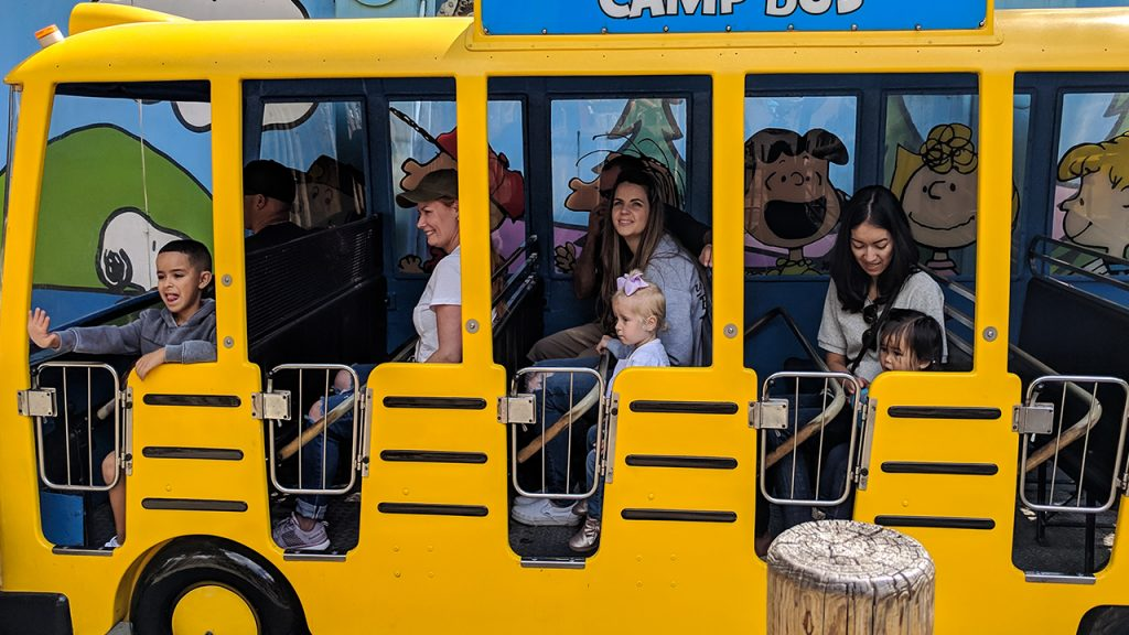 Children sit on a bus at Camp Snoopy at Knotts Berry Farm