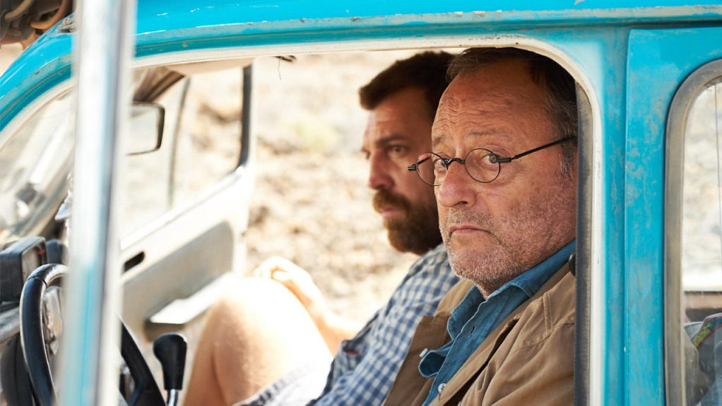 Promo image for 4 latas showing two men sitting in a truck in the desert