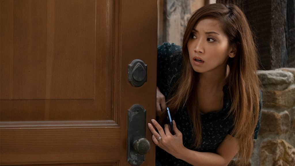 Promo image for Secret Obsession showing a woman peeking around a door