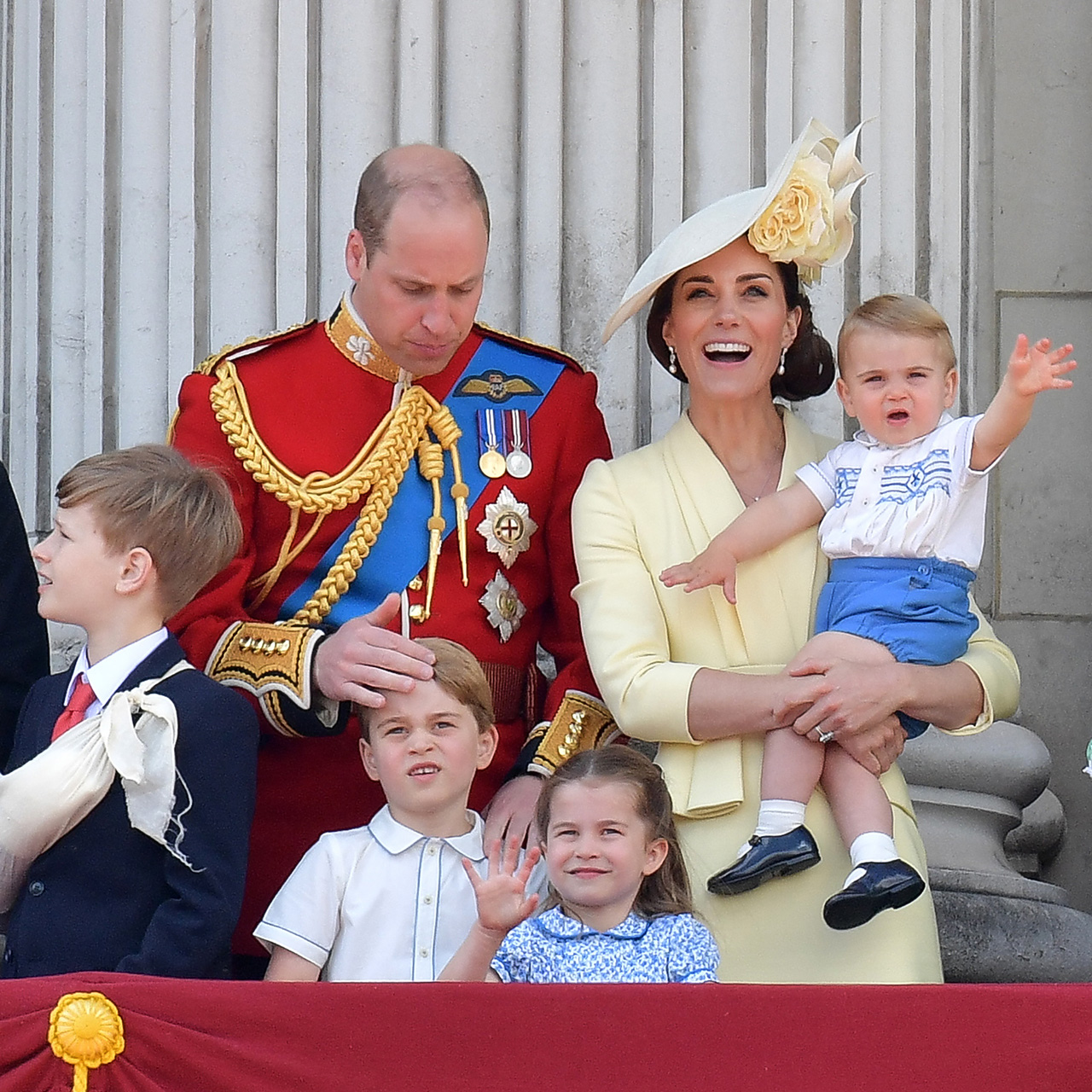 prince louis in Kate's arms waving