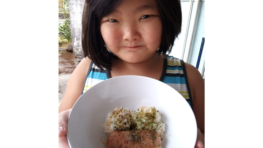 young girl eating omelette
