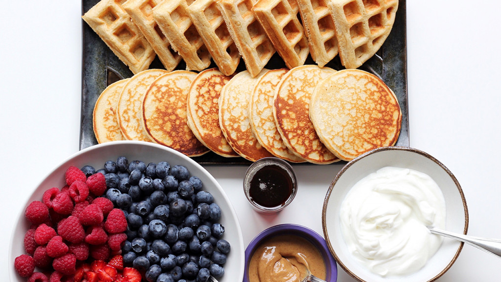 pancakes, waffles, berries, yogurt and peanut butter
