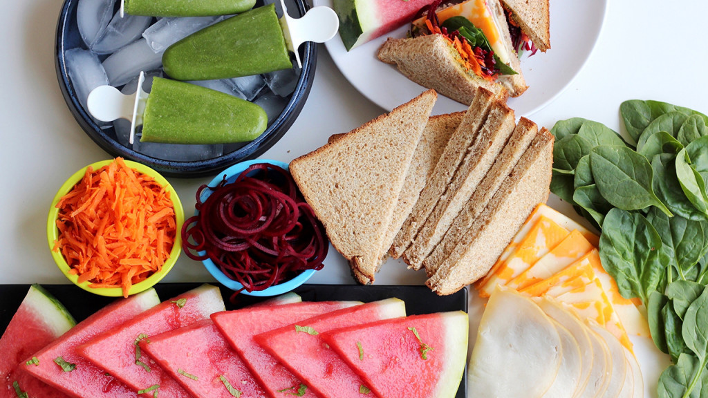 platter with bread, watermelon, cold cuts, cheese and popsicles