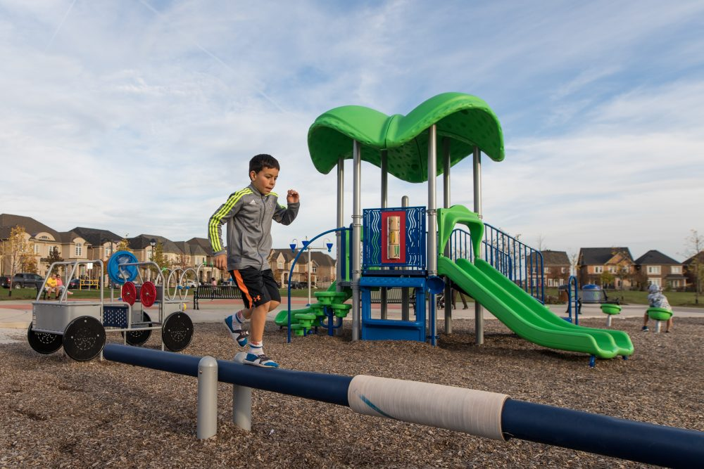 a kid playing in a brightly coloured playground