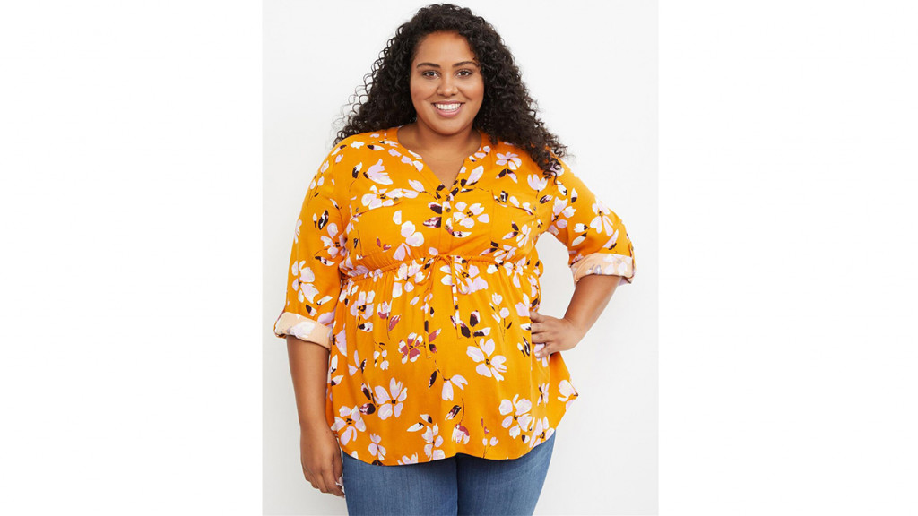 Woman wearing yellow plus size maternity top
