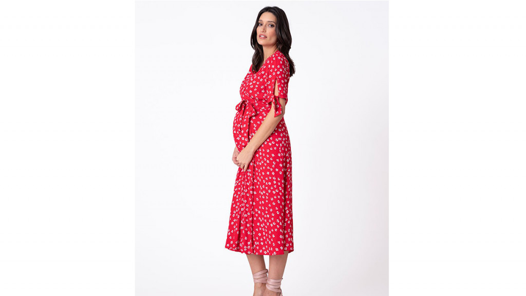 Woman wearing red midi maternity dress