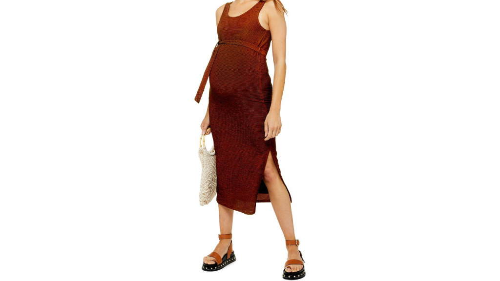 Woman in red maternity Topshop dress