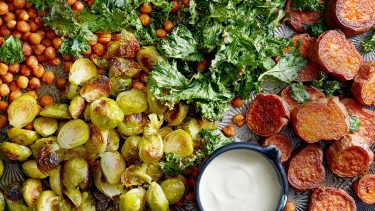 tray of roasted veggies with white sauce