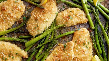 Sheet pan with breaded chicken and asparagus