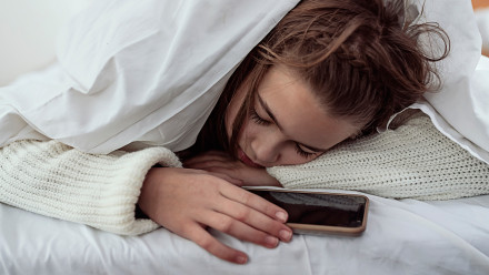 Teen girl sleeping with phone