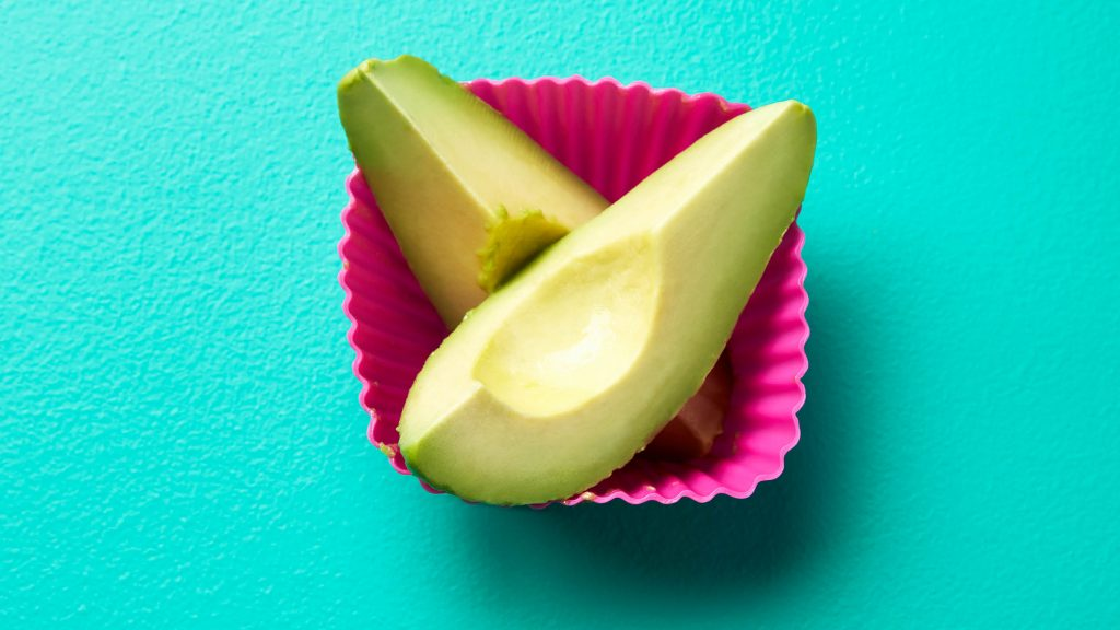 avocado spears in a pink cup