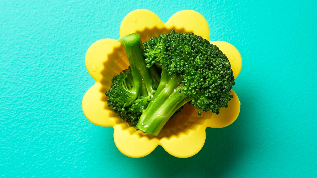 Steamed broccoli in a yellow flower-shaped cup