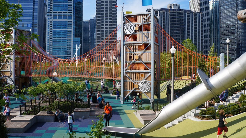 Photo of families playing at the giant play structure at Maggie Daley Park
