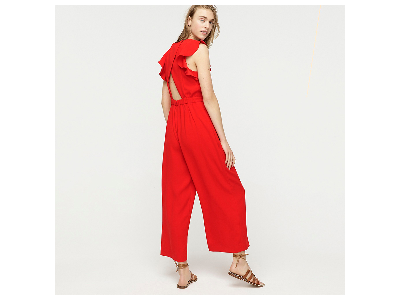 red jumpsuit with ruffled back detail
