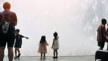 kids touching a fountain at Singapore's Changi busiest airport