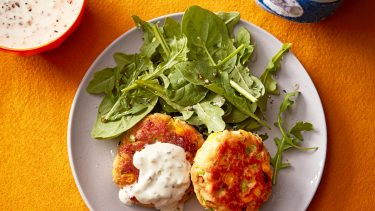 dish of tuna cakes with green salad