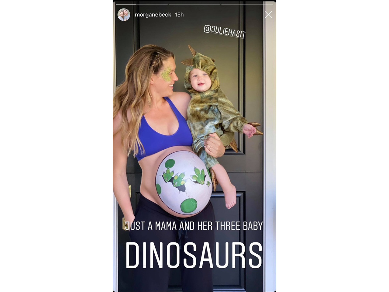 Morgan dressed as a dinosaur egg holding a baby dressed as a dinoasaur
