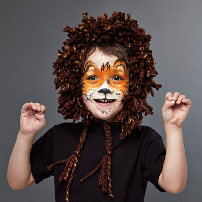 little boy with lion face painting