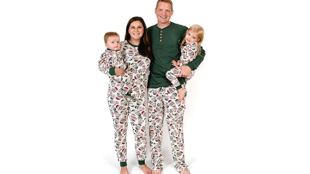 family of four in best family christmas pajamas