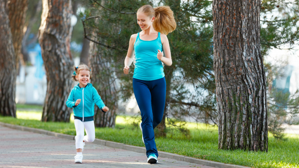 mother and daughter jogging in a park with a fitbit for kids