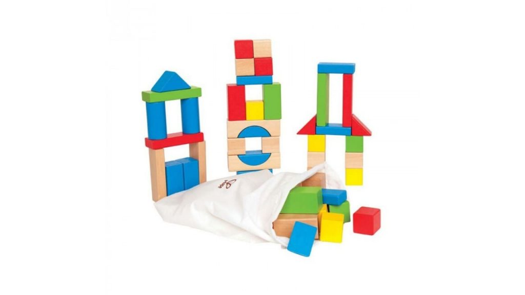 Stacked colourful wooden building blocks