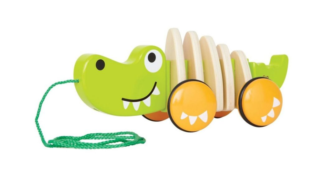 Wooden crocodile with string attached to its nose