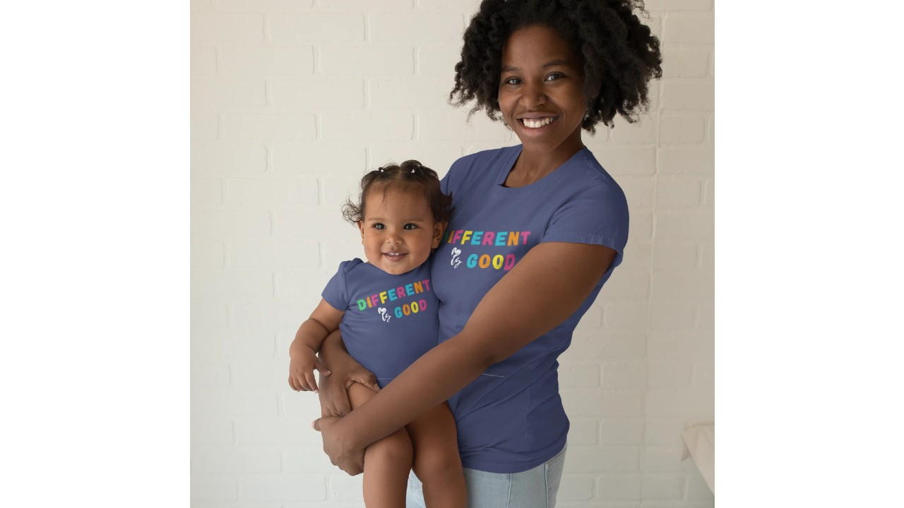 mom and baby wearing matching t-shirt and onesie