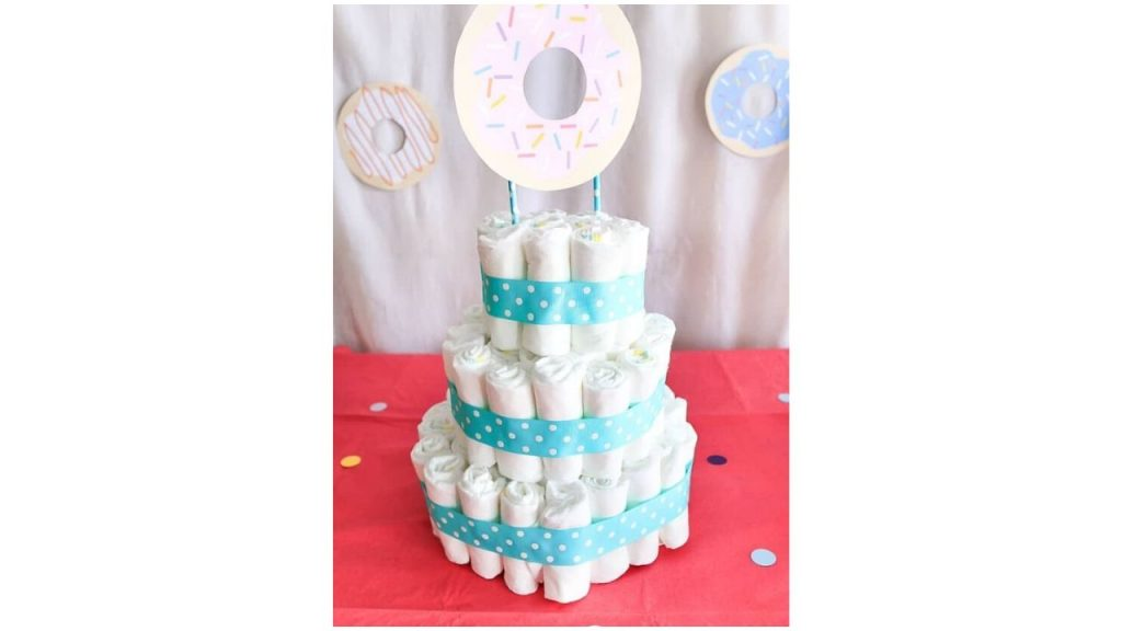 Three-layered diaper cake with cardboard donut on top