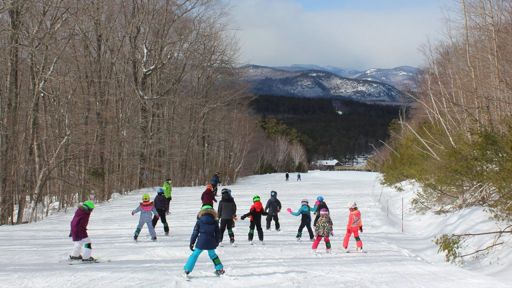 children skiing down a mountain