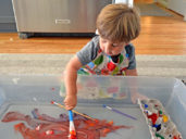 child painting as an indoor activity for kids