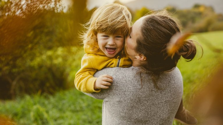 mom carrying a happy toddler infertility changed me