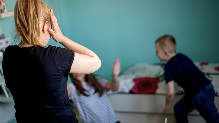 Frustrated mom with fighting kids