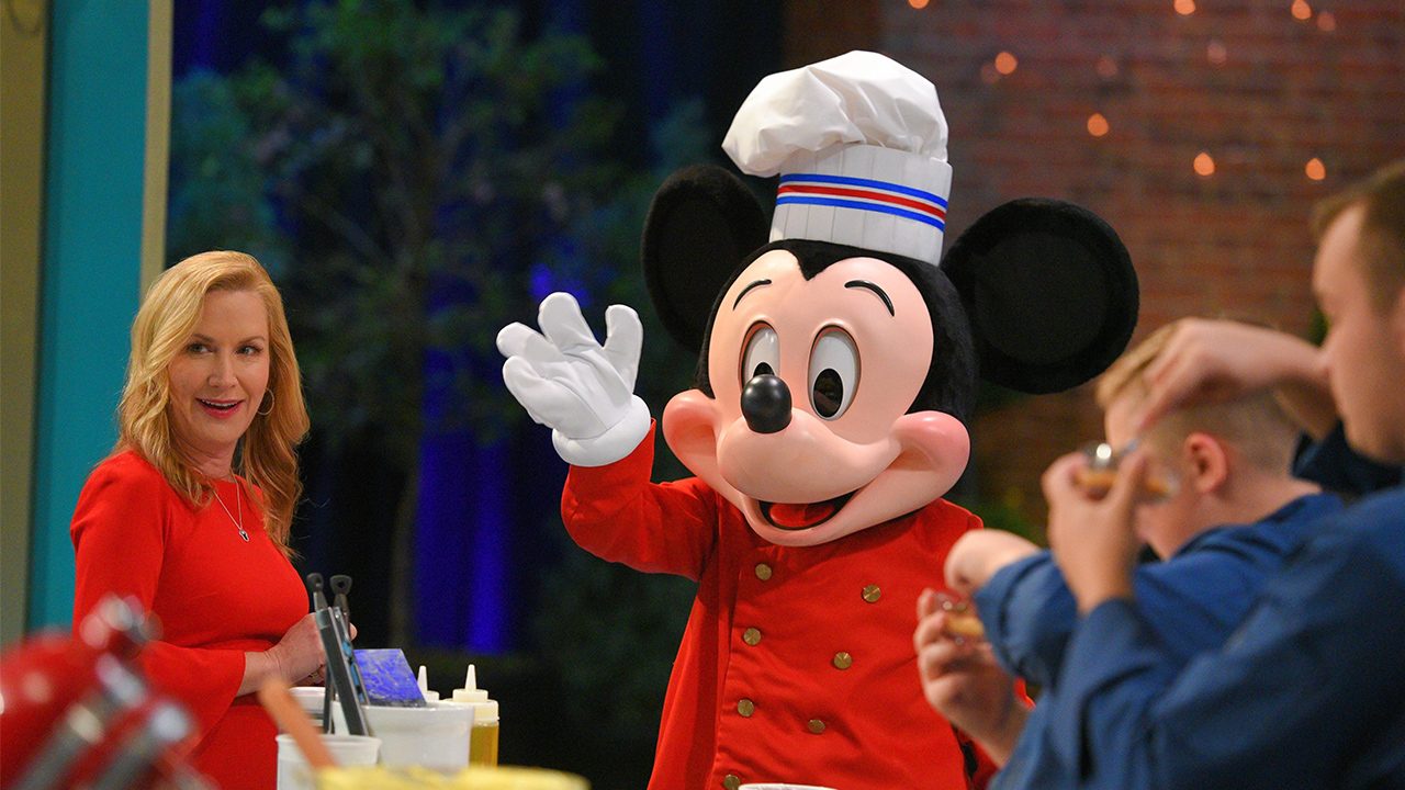 Mickey Mouse wearing a chef's hat and jacket