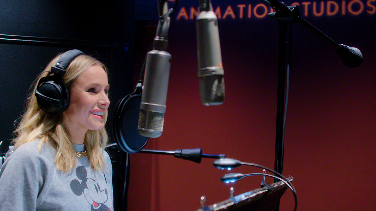 Kristen Bell in a voice over recording booth