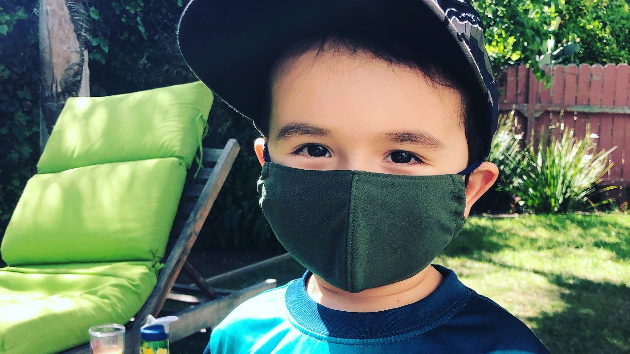 kid in protective face mask