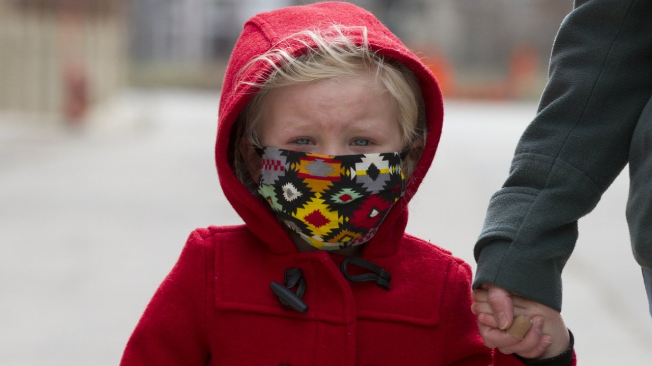 young girl wearing face mask in winter